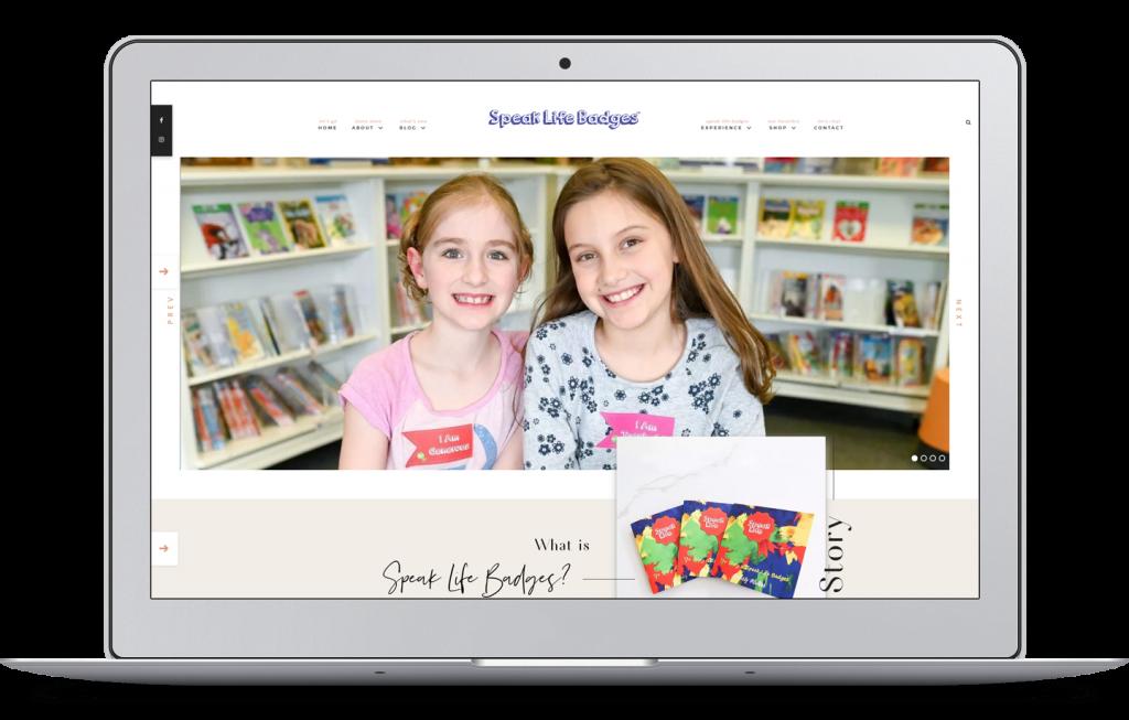 Laptop with Speak Life Badges Website